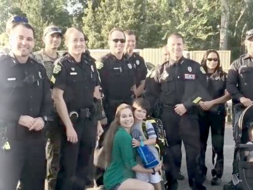 When an injured police officer couldn't make it to his son's first day of school, his entire squad went instead - and the adorable video is going viral
