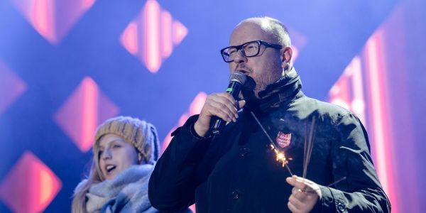 A Polish city mayor was stabbed to death in front of thousands of people at a charity event
