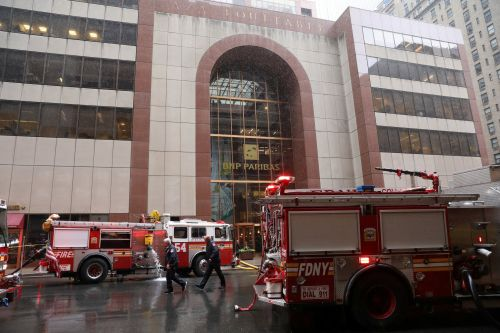 Photos and video show the scene where a helicopter crashed into the roof of a building in midtown Manhattan