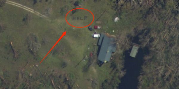 A Florida woman sent rescuers to save her family when she saw the word 'HELP' written in the grass on satellite images of the house after Hurricane Michael