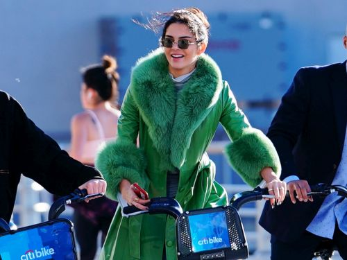 Kendall Jenner took a $3 bike ride while wearing a $1,933 green coat to celebrate her 23rd birthday