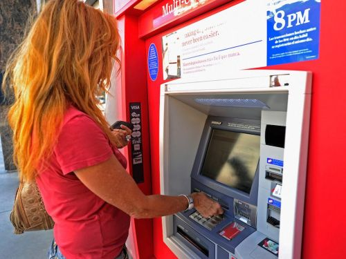 How to transfer money from one bank to another to combine finances or earn more interest
