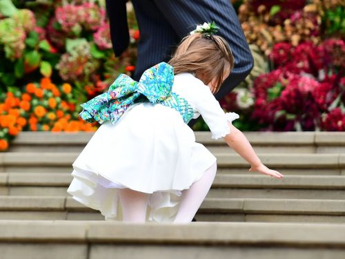 Princess Charlotte fell up the stairs at Princess Eugenie's wedding - but she still stole the show