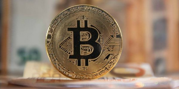 The world's biggest crypto fund manager says Bitcoin is the next step in the evolution of money - and 'I can't use it to buy coffee' is no longer a sound argument