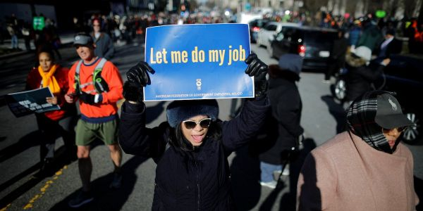 Federal employees say they're getting second jobs, including driving for Uber, to cope with the joint-longest shutdown in US history