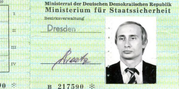 A pouting 1980s photo of Putin turned up in a Soviet-era stash of work IDs