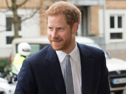 Prince Harry deviated from royal tradition to take a selfie with a young fan who lost his mother