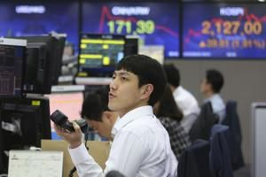 Asia markets mixed after Wall Street rises on better US data