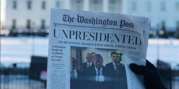 Left-wing prankster activists 'The Yes Men' hand out fake Washington Post newspapers at several D.C. locations