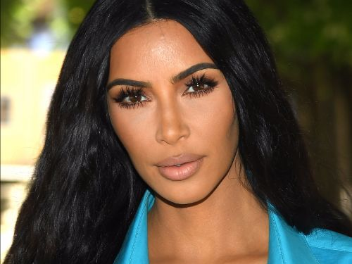 Kim Kardashian wore a jacket with so many pockets that she didn't even need to carry a purse