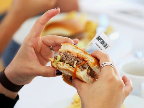 The Impossible Burger is hitting grocery store shelves in a direct play for Beyond Meat's retail turf