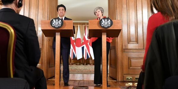 Japanese PM backs Theresa May's Brexit plans and says 'whole world' wants to avoid no-deal