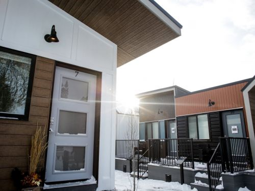 A village of 15 tiny houses designed for homeless veterans just opened in a Canadian city, and it charges veterans $600 a month to live there until they get back on their feet