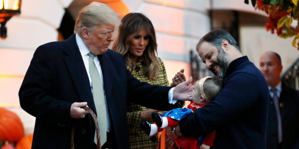 Trump celebrates Halloween by handing out candy to kids at the White House