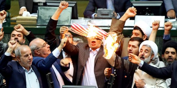 Iranian politicians set the US flag on fire and chanted 'death to America' after Trump pulled out of the Iran deal