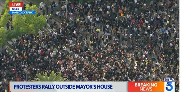 Thousands protested outside Los Angeles mayor's house, as the public also voiced outrage at LAPD during an emotional Zoom town hall