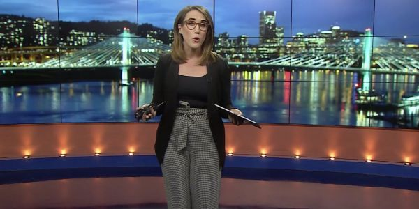 A news anchor who regularly wears pants on air fired back after a viewer told her to to try 'dressing like a normal woman'