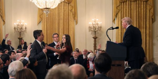 White House says CNN's Jim Acosta is 'no more or less special' than any other reporter and accuses him of 'monopolizing the floor' with questions in justifying revoking his press pass