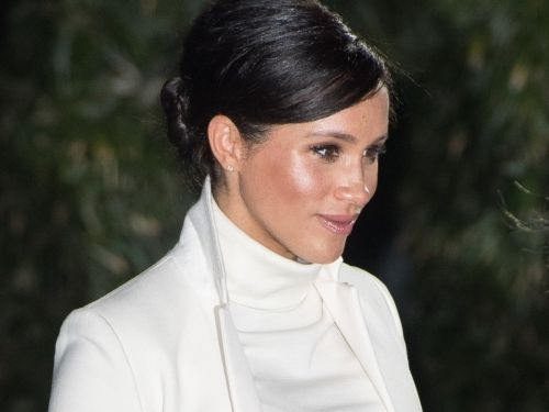 Meghan Markle layered a white turtleneck dress under a $1,190 coat for a chic yet cozy maternity look