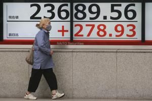 Asian shares track Wall Street fall as virus aid hopes fade