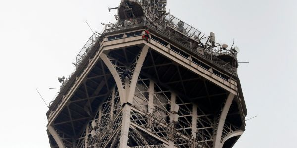 The Eiffel Tower has been 'closed until further notice' after a person was spotted scaling the 1,063-foot landmark