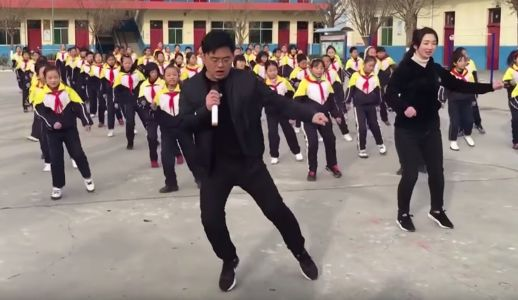 A video of a Chinese school principal performing a shuffle dance with his students has gone viral, and he does it with them every day to keep them active