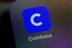 Coinbase soars in market debut, valued near $100 billion