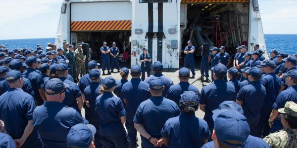 Unpaid Coast Guard members are deploying for a months-long mission in the Pacific - at home, their bosses are warning about their houses
