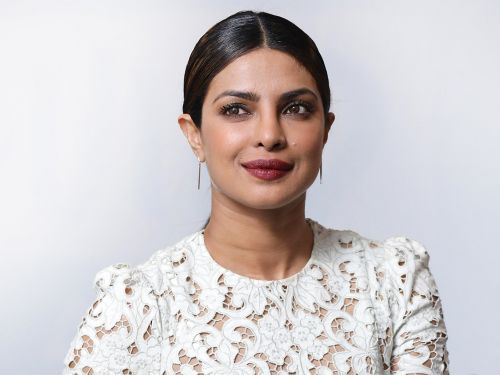 Priyanka Chopra wore another white dress covered in feathers ahead of her wedding, and it could be a hint at her bridal style