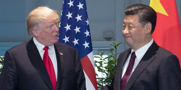Trump's trade war is heating up - here are 11 stocks UBS says to avoid