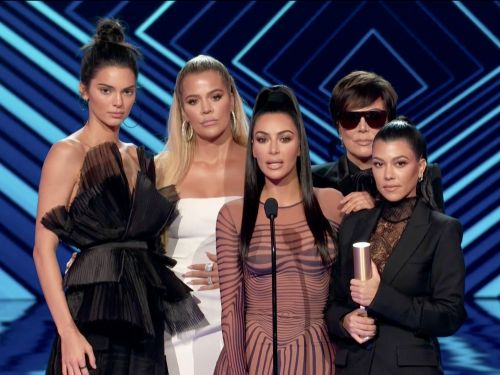 People are trolling Kris Jenner over her massive sunglasses at the People's Choice Awards - including her own daughters