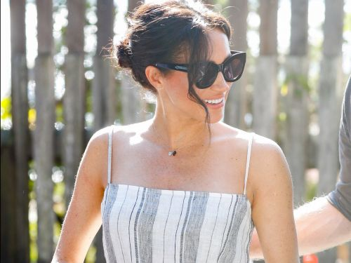 Meghan Markle ditched her usual royal style for a summer dress with a thigh-high slit from an eco-friendly brand