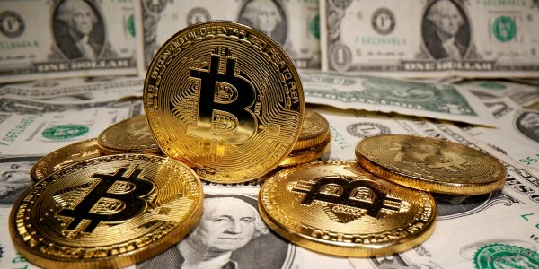 Here is why booming bitcoin will never be a form of payment, according to 5 experts