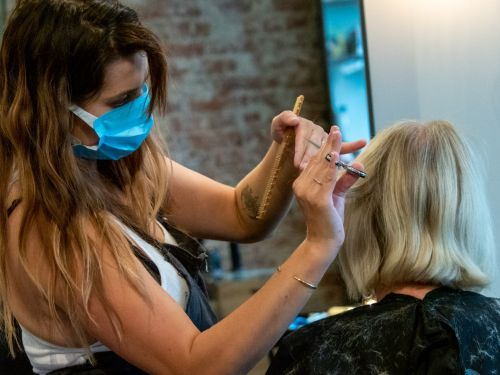 You can spread COVID-19 by talking in hair salons or during a massage - even while wearing a mask, research suggests