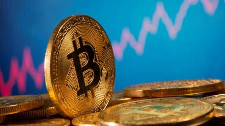 Bitcoin price breaks all-time record, nearing $20,000 as cryptocurrency bounces back from March slump