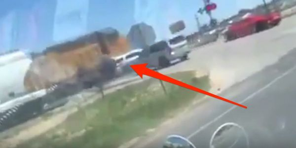 Dramatic video shows a Texas sheriff's deputy's SUV getting plowed by a moving train and rolling over