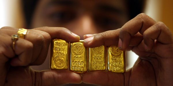 Gold slumps to lowest in eight months as market 'finally wakes' up' to spiking bond yields