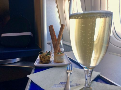 I used credit card points to score a $20,000 seat on ANA to Japan. Here's what life is like in first class, from fresh sashimi to $300 Champagne