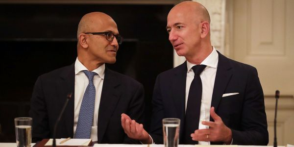 CEO Satya Nadella says that Microsoft is embracing Amazon's Alexa instead of fighting it - and he wants to be friends with Google, too
