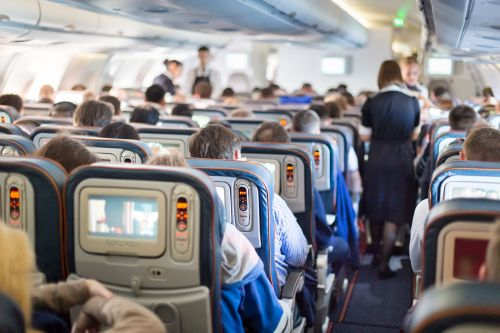 An Air France passenger says a flight attendant offered to move her seat and 'just shrugged' when a man took off his pants mid-air