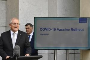 The Latest: France's Macron wants to speed up vaccinations