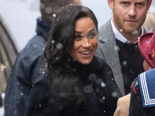Meghan Markle wore a $695 pair of olive-green boots in the snow, but her animal-print dress stole the show