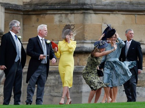 Hilarious photos of guests struggling with high winds at Princess Eugenie's royal wedding