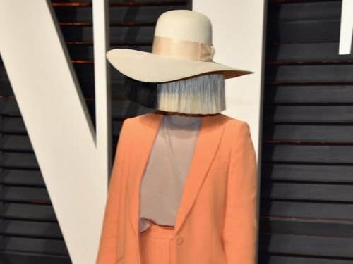 Sia appeared without one of her signature giant wigs - and it's one of the few times we've ever seen her face