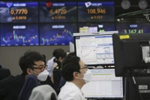 World shares mixed as economic data cloud outlook