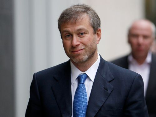 Russian billionaire Roman Abramovich owns the second-largest yacht in the world and a customized airplane with a 30-person banquet hall - see how else he spends his fortune of at least $11 billion