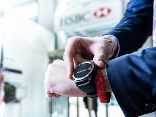 HSBC is making a $130 million investment in its bank branches and the latest step is to arm its bankers with Samsung watches