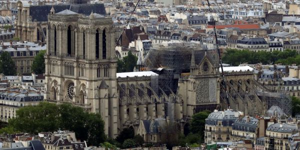 Notre-Dame says the billionaires who pledged to rebuild the cathedral haven't paid 'a cent' yet, and most of the money so far has come from regular Americans