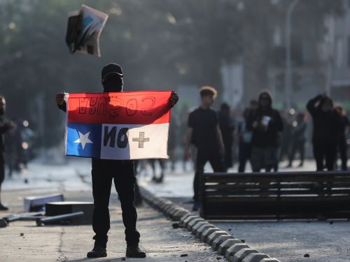 3 are dead after Chilean protesters staged violent demonstrations over a subway fare hike, burning buildings and bringing the country's capital to a standstill