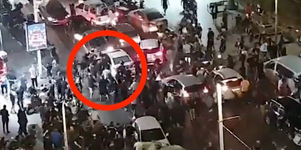 Video shows a mob in Israel dragging a man they think is Arab out of his car and beating him